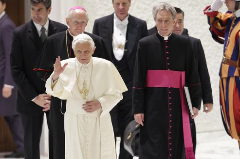 Pope Benedict XVI waves as he arrives to lead a special audience in Paul VI hall at the Vatican